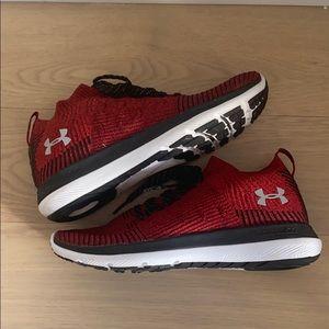 Vibrant red UA shoes